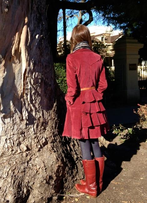Coat with ruffle back
